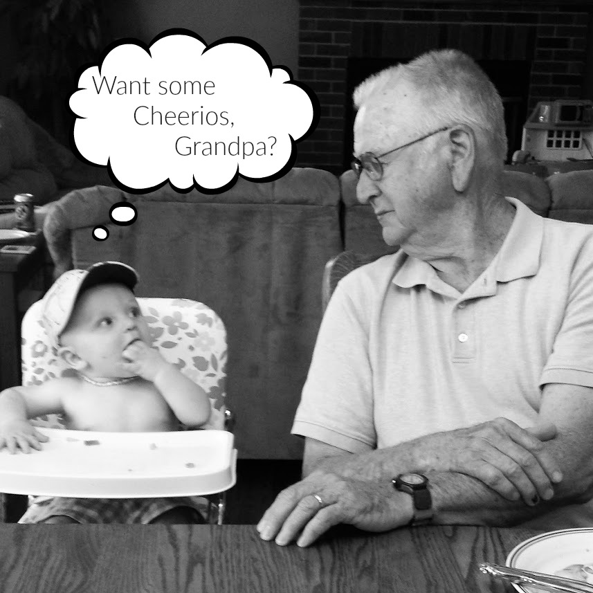 Grandpa and great-grandson sharing Cheerios